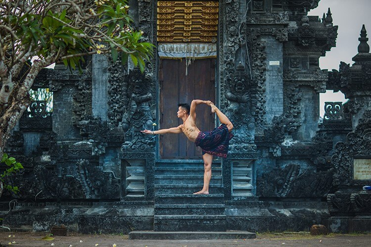 yoga teacher training in Bali. Natarajasana pose outside Bali temple