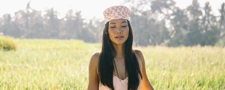 Girl in rice field in Ubud Bali wearing Ompure