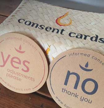 "yoga classes in bali now use ""touch consent cards"""